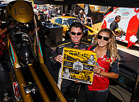 Jul 8, 2017; Joliet, IL, USA; NHRA top fuel driver Leah Pritchett (right) and Papa Johns Pizza founder John Schnatter during qualifying for the Route 66 Nationals at Route 66 Raceway. Mandatory Credit: Mark J. Rebilas-USA TODAY Sports