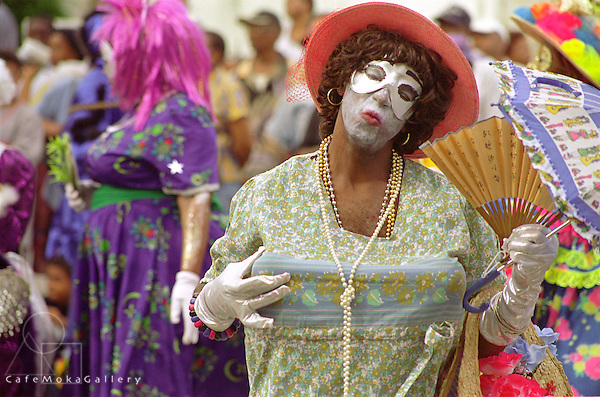 Trinidad carnival,traditional mas character. Man dressed as a Dame Lorraine blowing a kiss