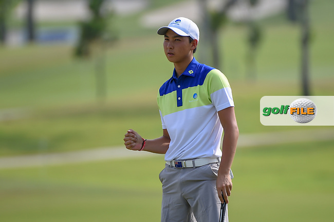 Min Woo LEE (AUS) reacts to sinking his long birdie putt on 5 during Rd 3 of the Asia-Pacific Amateur Championship, Sentosa Golf Club, Singapore. 10/6/2018.<br /> Picture: Golffile | Ken Murray<br /> <br /> <br /> All photo usage must carry mandatory copyright credit (© Golffile | Ken Murray)