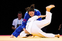 04 DEC 2011 - LONDON, GBR - Sally Conway (GBR) (in blue) tries to overpower Maria Portela (BRA) (in white) during the women's -70kg final at the London International Judo Invitational and 2012 Olympic Games test event at the ExCel Exhibition Centre in London, Great Britain (PHOTO (C) NIGEL FARROW)
