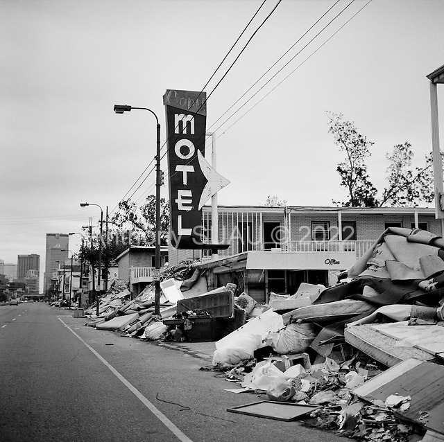 New Orleans, Louisiana.USA.December 2, 2005 ..A central New Orleans motel empties its damaged contains onto the street.