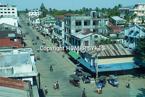 Sittwe Northern Rakhaing province Myanmar (Burma) 2008. Main street through tinted glass windows of hotel.