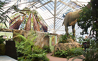 San Francisco Conservatory of Flowers Plantosaurus exhibit with T. rex dinosaur and Saxon Holt photo murals, redwood trees