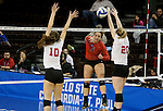 SIOUX FALLS, SD - DECEMBER 8:  Kayce Krucki #5 from Wheeling Jesuit rips the ball past Caroline Stefanon #10 and Maddie Seliga #20 from Lewis during their quarterfinal match at the 2016 Women's Division II Volleyball Championship at the Sanford Pentagon in Sioux Falls, SD. (Photo by Dave Eggen/Inertia)