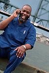 Happy African American man talking on cell phone