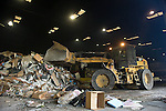 A CAT 922 front loader pushes and stacks a load of cardboard and other materials around in the transfer station at Mission Trail Waste Systems in Santa Clara, Calif. The Tractor condenses the loads and prepares it for the transfer trailer to haul it off.