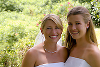 A bride and her bridesmaid sister at a wedding in Kailua