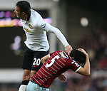 West Ham's James Tomkins gets caught in the face by Manchester United's Robin Van Persie<br /> <br /> Barclays Premier League- West Ham United vs Manchester United  - Upton Park - England - 8th February 2015 - Picture David Klein/Sportimage