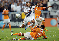 CARSON, CA - DECEMBER 01, 2012:   Sean Franklin (5) of the Los Angeles Galaxy leaps over Jermaine Taylor (4) of the Houston Dynamo during the 2012 MLS Cup at the Home Depot Center, in Carson, California on December 01, 2012. The Galaxy won 3-1.