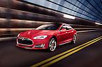 Red Tesla Model S luxury electric car speeding along a metal industrial tunnel