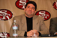 SANTA CLARA, CA - Owner Eddie DeBartolo watches as new head coach Steve Mariucci of the San Francisco 49ers is introduced to the media at the Marie P. DeBartolo Sports Centre in Santa Clara, California on January 15, 1997. (Photo by Brad Mangin)