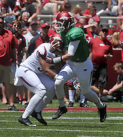 NWA Democrat-Gazette/Michael Woods --04/25/2015--w@NWAMICHAELW... University of Arkansas quarterback Brandon Allen runs the ball for a gain during the 2015 Red-White game Saturday afternoon at Razorback Stadium in Fayetteville.