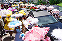 Friends, family and baby dolls say goodbye as they lay Tee Eva Perry to rest with a funeral and secondline in Central City.