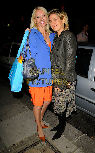 """ANNEKA RICE & PENNY SMITH.Attending Kathy Lette's """"To Love, Honour and Betray"""" book launch party, London, England. .September 24th 2008.full length grey gray leather jacket lace print dress blue bag aneka coat orange skirt red shoes.CAP/CAN.©Can Nguyen/Capital Pictures."""