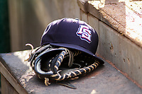 A Colorado Springs Sky Sox hat sits on the dugout steps during game one of a Pacific Coast League doubleheader against the Iowa Cubs on August 17, 2017 at Principal Park in Des Moines, Iowa. Iowa defeated Colorado Springs 1-0. (Brad Krause/Four Seam Images)