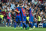 Ivan Rakitic, Luis Suarez  and Leo Messi  of FC Barcelona celebrates after scoring a goal during the match of La Liga between Real Madrid and Futbol Club Barcelona at Santiago Bernabeu Stadium  in Madrid, Spain. April 23, 2017. (ALTERPHOTOS)