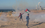Palestinian demonstrators take part in a protest on the beach along the northern Gaza border, across from the Israeli settlement of Kibbutz Zikim, on  March19, 2019, as part of weekly maritime protests against the naval blockade of the coastal enclave. Many attempts have been made throughout the years to draw the public's attention to the ongoing siege of the Gaza Strip whether via ships attempting to sail into or out of Gaza. Photo by Ashraf Amra