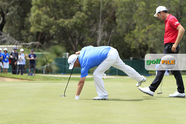Damian McGrane (IRL) on the 18th green during Round 3 of the ISPS HANDA Perth International at the Lake Karrinyup Country Club on Saturday 25th October 2014.<br /> Picture:  Thos Caffrey / www.golffile.ie