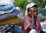 A survivor of the January 12 earthquake sits dejectedly in the Port-au-Prince neighborhood of Belair.