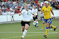 Amy Rodriguez #8, Sara Thunebro...USWNT tied Sweden 1-1 at Morison Stadium, Nebraska.