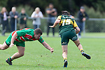 Trent White skips past Luke Rosa. Counties Manukau Premier Club rugby game between Pukekohe and Waiuku, played at Colin Lawrie Fields, Pukekohe on Saturday April 14th, 2018. Pukekohe won the game 35 - 19 after leading 9 - 7 at halftime.<br /> Pukekohe Mitre 10 Mega -Joshua Baverstock, Sione Fifita 3 tries, Cody White 3 conversions, Cody White 3 penalties.<br /> Waiuku Brian James Contracting - Lemeki Tulele, Nathan Millar, Tevta Halafihi tries,  Christian Walker 2 conversions.<br /> Photo by Richard Spranger