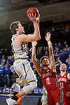 BROOKINGS, SD - DECEMBER 31:  Mike Daum #24 from South Dakota State University kicks down a short jumper over Trey Burch-Manning #12 from the University of South Dakota for the winning basket with 2.8 seconds to play in their game Saturday afternoon at Frost Arena in Brookings. (Dave Eggen/Inertia)
