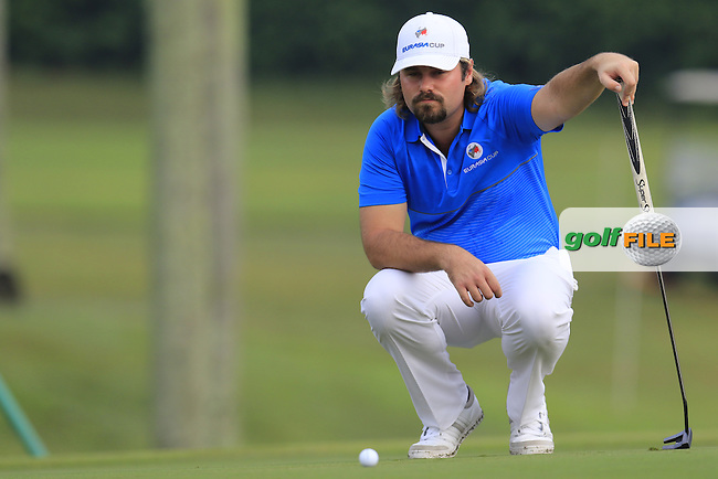 Victor Dubuisson (FRA) Team Europe lines up his putt on the 1st green during Match 1 of Friday's Fourball Matches of the 2016 Eurasia Cup presented by DRB-HICOM, held at the Glenmarie Golf &amp; Country Club, Kuala Lumpur, Malaysia. 15th January 2016.<br /> Picture: Eoin Clarke | Golffile<br /> <br /> <br /> <br /> All photos usage must carry mandatory copyright credit (&copy; Golffile | Eoin Clarke)