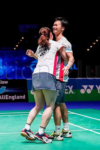 18th March 2018, Arena Birmingham, Birmingham, England; Yonex All England Open Badminton Championships; Yuta Watanabe (JPN) and Arisa Higashino (JPN) celebrate winning with a hug in the mixed doubles final against Zheng Siwei (CHN) and Huang Yaqiong (CHN)