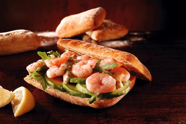 Prawn, avacado and rocket  chiabatta sandwich. Food photos.