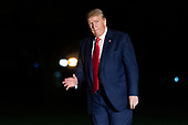 United States President Donald J. Trump waves to the press as he returns to the White House in Washington, DC after speaking at a Keep America Great Rally in Minneapolis, Minnesota on October 11, 2019. <br /> Credit: Chris Kleponis / Pool via CNP