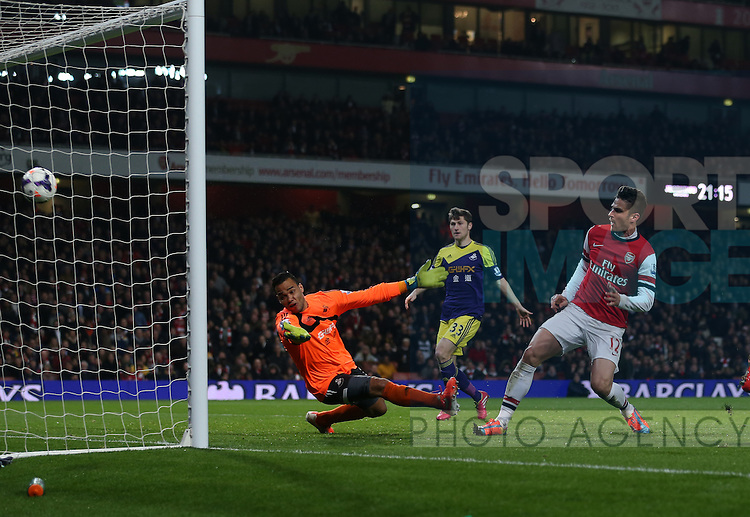 Arsenal's Olivier Giroud scoring his sides second goal<br /> <br /> Arsenal vs Swansea City - Premier League - Emirates Stadium- London - England - 25/03/2014  - Pic David Klein/Sportimage