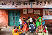 A man speaks to his son while other women patients wait for their turn at the general OPD of the Duncan Hospital in Raxaul, Bihar, India.