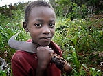 A boy pauses from agricultural work in Mizak, a small village in the south of Haiti.