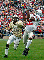 Ohio State Michael Jenkins (cq) 12, makes the go ahead touchdown reception over Purdue's Antwaun Rogers (cq) 12, in the fourth quarter of their game at Ross-Ade Stadium in West Lafayette, Indiana, November 9, 2002. The Buckeyes came from behind to beat the Boilermakers 10 -6.  (Dispatch photo by Neal C. Lauron)