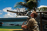 Young boy looking at Anti-Aircraft guns, Pearl Harbor, Oahu, Hawaii
