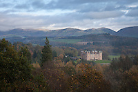 A romantic view of Drumlanrig Castle, set against a dramatic backdrop of Scottish mountains