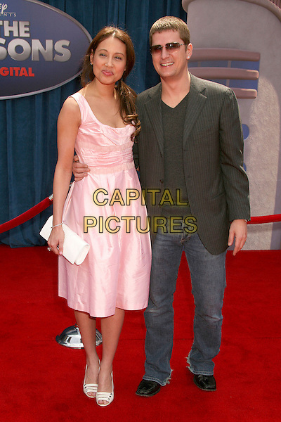 "MARISOL THOMAS & ROB THOMAS .""Meet The Robinsons"" Los Angeles Premiere at the El Capitan Theatre, Hollywood, California, USA..March 25th, 2007.full length pink dress jeans denim black suit jacket sunglasses shades white clutch purse .CAP/ADM/BP.©Byron Purvis/AdMedia/Capital Pictures"