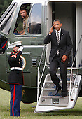 United States President Barack Obama saluters the Marine Guard as he arrives at the White House after a trip to Iowa on July 10, 2012..Credit: Dennis Brack / Pool via CNP