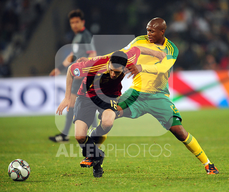 Sergio Busquets and Kagisho Dikgaloi  during the soccer match of the 2009 Confederations Cup between Spain and South Africa played at the Freestate Stadium,Bloemfontein,South Africa on 20 June 2009.  Photo: Gerhard Steenkamp/Superimage Media.