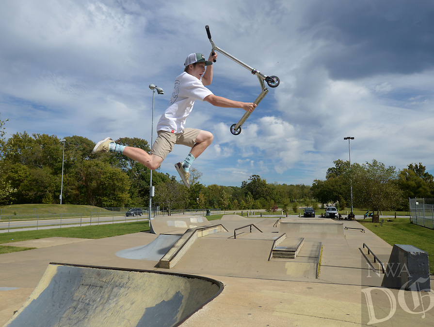 NWA Democrat-Gazette/BEN GOFF @NWABENGOFF<br /> Nathan Webster of Cave Springs does tricks on his scooter on Sunday Oct. 10, 2016 at the skate park at Memorial Park in Bentonville.