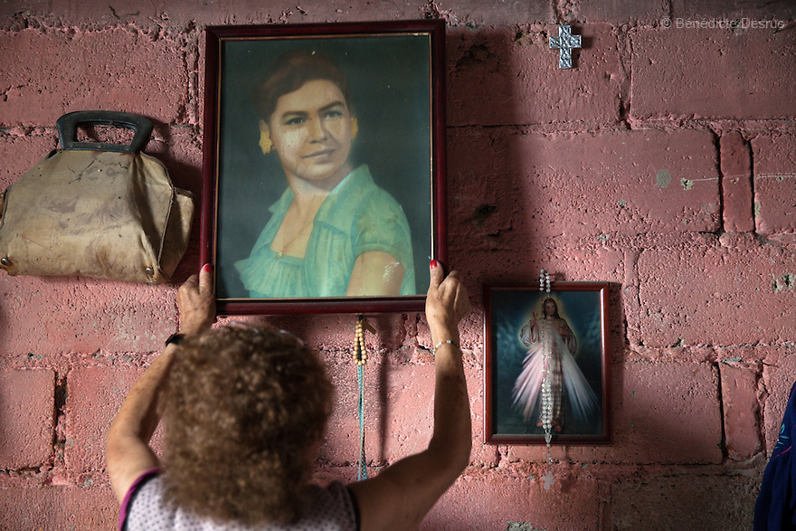 Victoria, a resident of Casa Xochiquetzal, holds an old picture at her family's house in Pachuca, a city located an hour northeast of Mexico City, Mexico on June 26, 2013. Casa Xochiquetzal is a shelter for elderly sex workers in Mexico City. It gives the women refuge, food, health services, a space to learn about their human rights and courses to help them rediscover their self-confidence and deal with traumatic aspects of their lives. Casa Xochiquetzal provides a space to age with dignity for a group of vulnerable women who are often invisible to society at large. It is the only such shelter existing in Latin America. Photo by Bénédicte Desrus