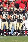 Palos Verdes, CA 11/12/10 - Jin Matsumoto (Peninsula #40), Tommy Webster (Peninsula #49) and Ken Martin (Peninsula #22) in action during the Palos Verdes - Peninsula varsity football game at Peninsula High School.