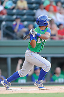 Designated hitter Carlos Garcia (6) of the Lexington Legends bats in a game against the Greenville Drive on Friday, August 29, 2014, at Fluor Field at the West End in Greenville, South Carolina. Greenville won, 6-1. (Tom Priddy/Four Seam Images)