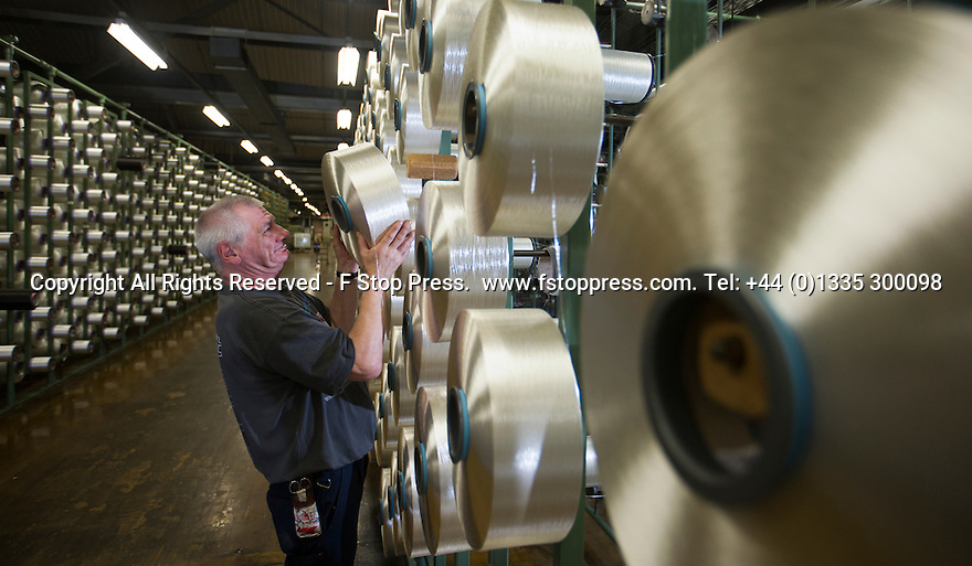 13/01/15<br /> <br /> 'Warper', Bryan Carter, 59 checks the 'cheeses'.<br /> <br /> Full story here: http://www.fstoppress.com/articles/mayfield-yarns/<br /> <br /> If you've ever struggled to untangle the wires on your headphones, an electrical extension cable or a reel of fishing line, then spare a thought for the workers at Britain's largest yarn processors who are responsible for keeping 2½ million metres of gossamer-thin thread, tangle and snag-free each week...<br /> <br /> ***ANY UK EDITORIAL PRINT USE WILL ATTRACT A MINIMUM FEE OF £130. THIS IS STRICTLY A MINIMUM. USUAL SPACE-RATES WILL APPLY TO IMAGES THAT WOULD NORMALLY ATTRACT A HIGHER FEE . PRICE FOR WEB USE WILL BE NEGOTIATED SEPARATELY - EXISTING AGREEMENTS FOR WEBUSE APPLY***<br /> All Rights Reserved - F Stop Press.  www.fstoppress.com. Tel: +44 (0)1335 300098