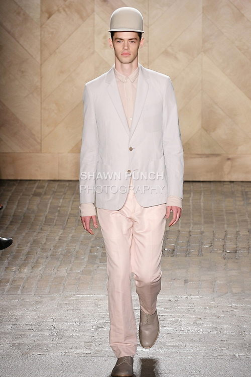 Logan Nickell walks runway in an outfit from the Perry Ellis by Duckie Brown Spring Summer 2013 collection, during New York Fashion Week Spring 2013.