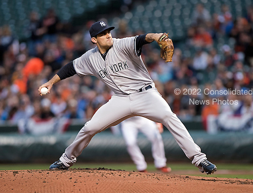 New York Yankees starting pitcher Nathan Eovaldi (30) works in the first inning against the Baltimore Orioles at Oriole Park at Camden Yards in Baltimore, MD on Wednesday, April 15, 2015. <br /> Credit: Ron Sachs / CNP<br /> (RESTRICTION: NO New York or New Jersey Newspapers or newspapers within a 75 mile radius of New York City)