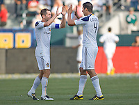 LA Galaxy defenders Gregg Berhalter (16-l) and teammate defender Omar Gonzalez (4-r) congratulate each after a Tristan Bowen Galaxy goal. The LA Galaxy defeated the Houston Dynamo 4-1 at Home Depot Center stadium in Carson, California on Saturday evening June 5, 2010..