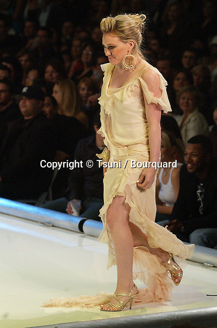 Hilary Duff on the runway at the GM and TEN Fashion Show in the heart of Holywood in Los Angeles. February 22, 2005.