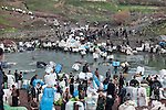 28/12/2014 -- Shabaddin, Iraqi Kurdistan -- Iran-Iraq border.  A large number of smugglers cross Shabaddin river, the border between Iraq and Iran. The Iranian army observe from distance after having received a small fee to avoid creating troubles.