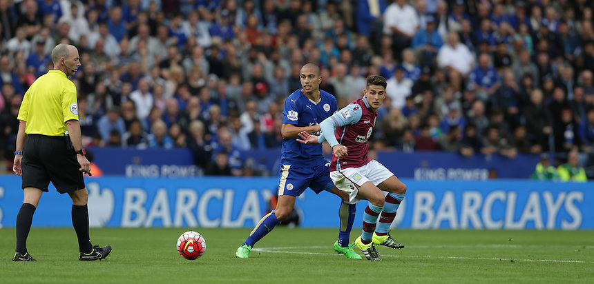 Leicester City's Gokhan Inler and Aston Villa's Ashley Westwood<br /> <br /> Photographer Stephen White/CameraSport<br /> <br /> Football - Barclays Premiership - Leicester City v Aston Villa - Sunday 13th September 2015 - King Power Stadium - Leicester<br /> <br /> &copy; CameraSport - 43 Linden Ave. Countesthorpe. Leicester. England. LE8 5PG - Tel: +44 (0) 116 277 4147 - admin@camerasport.com - www.camerasport.com